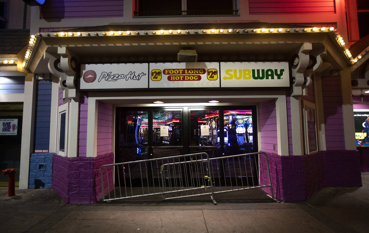 A door to Casino Royale is blocked as the casino has closed for the next 30 days due to coronav ...