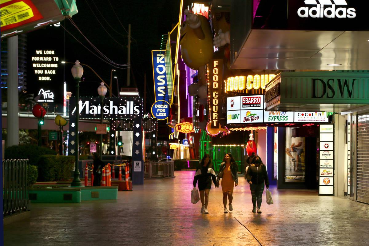 A few pedestrians walk along Las Vegas Blvd. north of the MGM Grand as non-essential business c ...