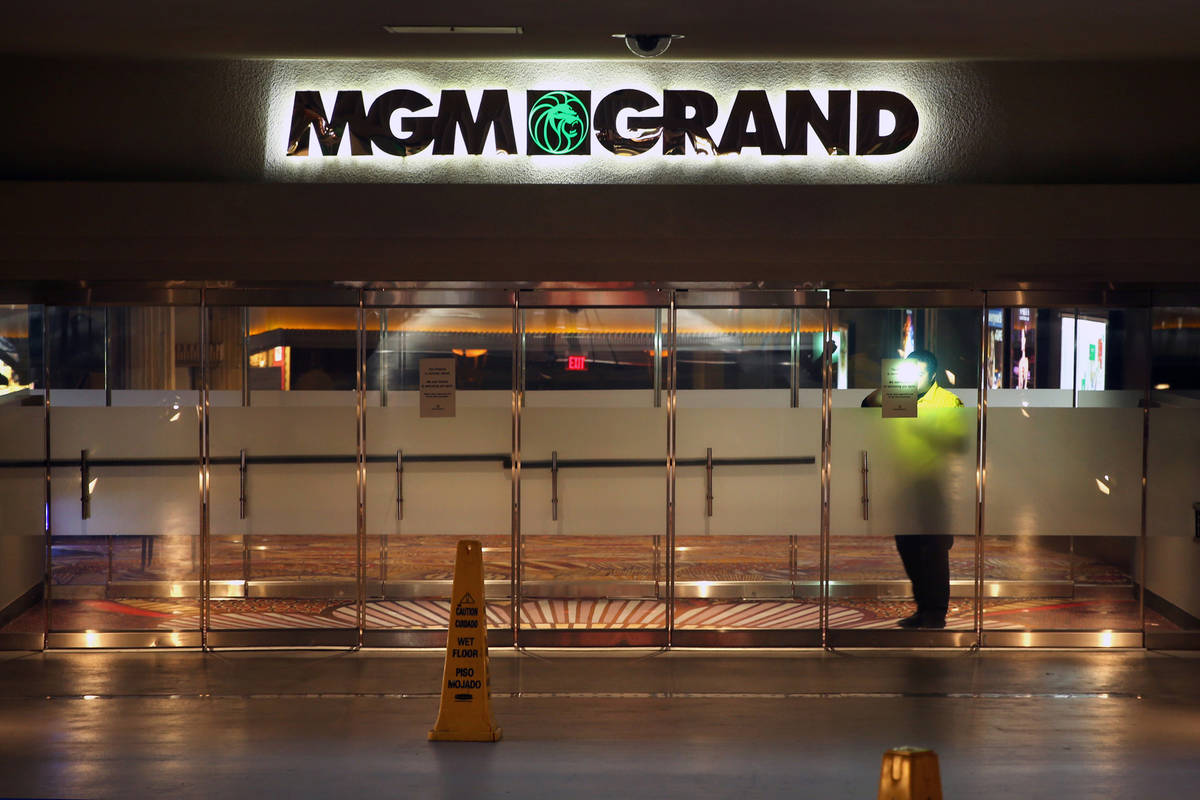 A security guard patrols inside the outer doors of the MGM Grand as non-essential business clos ...