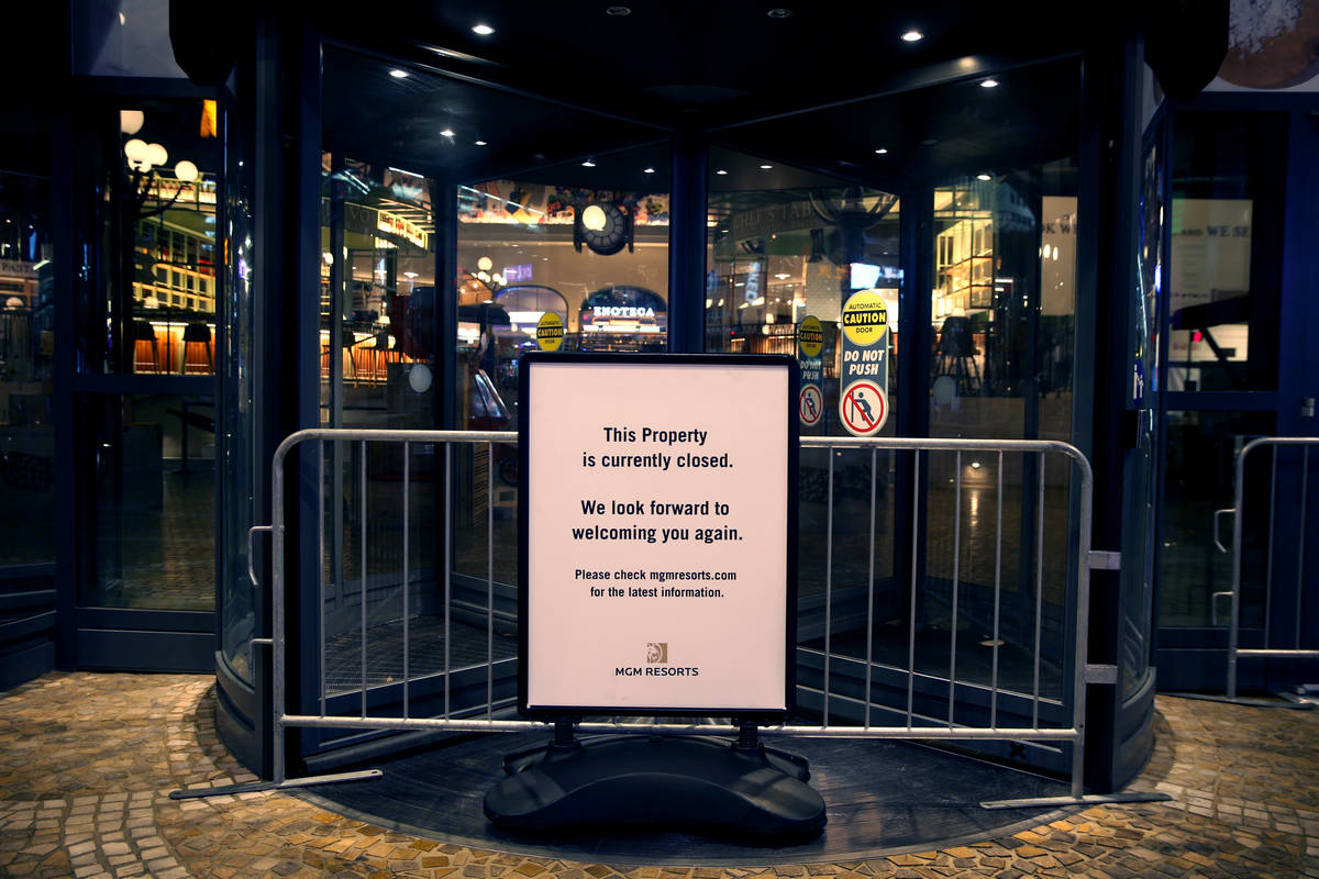 A sign notifies the public that Eataly is temporarily closed as non-essential business closures ...