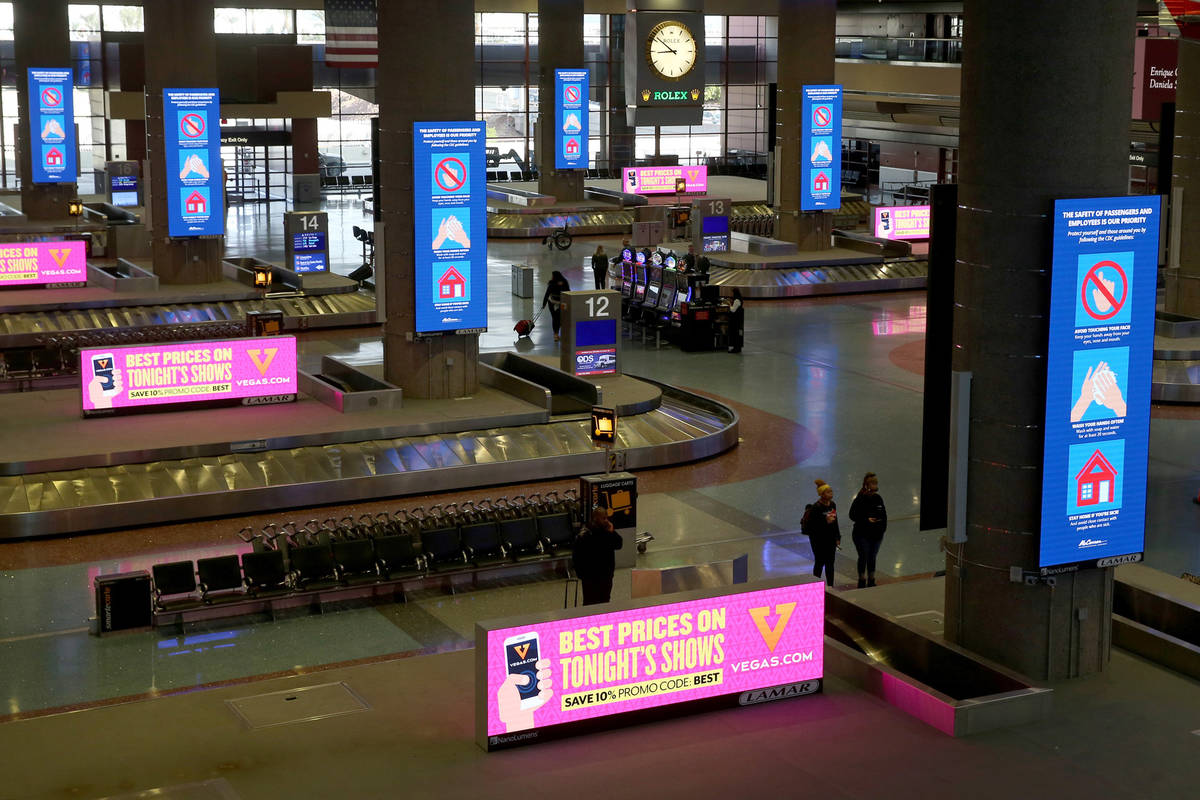 Safety signs at the baggage claim area at McCarran International Airport in Las Vegas Monday, M ...