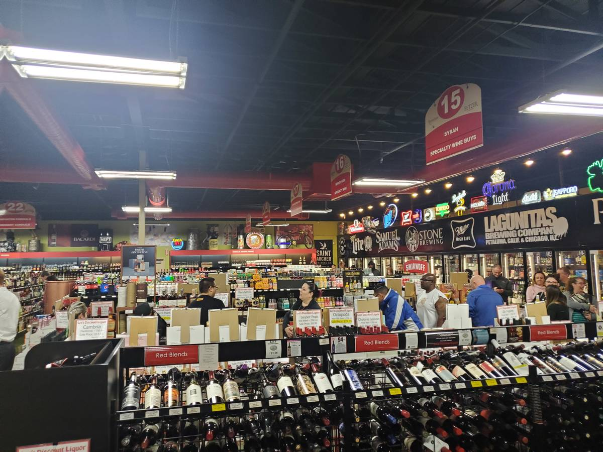 The line to the cashier at a Lee's Discount Liquor Tuesday night. (Adam Hill/Las Vegas Review-J ...