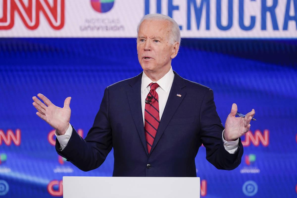 In a Sunday, March 15, 2020, file photo, former Vice President Joe Biden, participates in a Dem ...