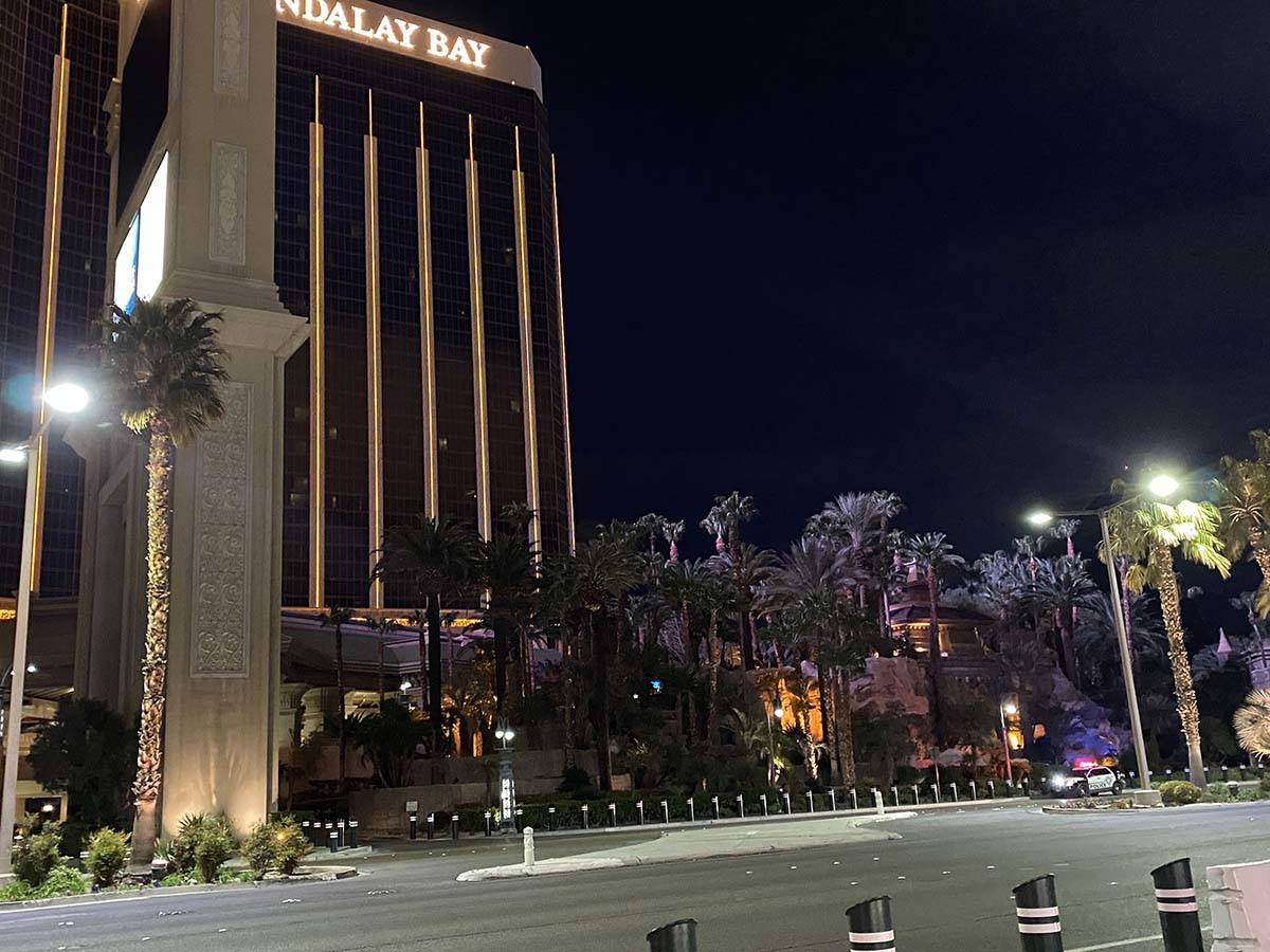 Police sit outside Mandalay Bay, which closed its doors Tuesday amid the coronavirus outbreak. ...