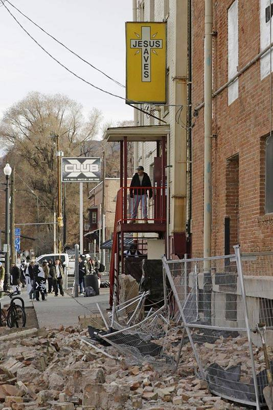 A man looks at the rubble after an earthquake Wednesday, March 18, 2020, in Salt Lake City. A ...