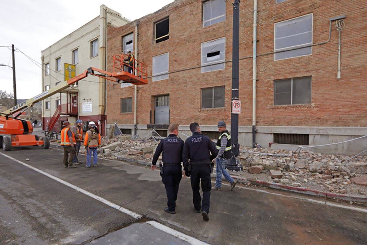 Police officers walk pass rubble after an earthquake Wednesday, March 18, 2020, in Salt Lake Ci ...