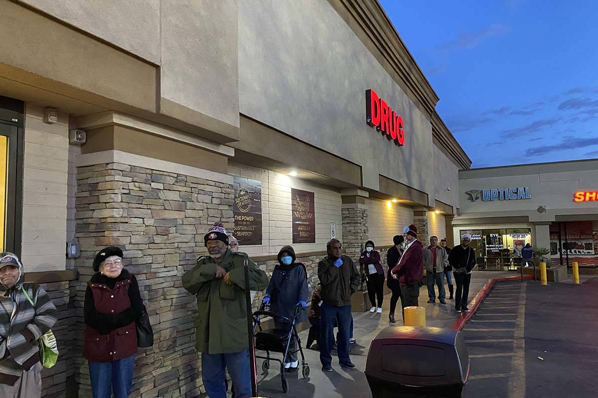 Seniors line up outside a Smith's store on North Rancho Drive on Wednesday, March 18, 2020. (Gl ...