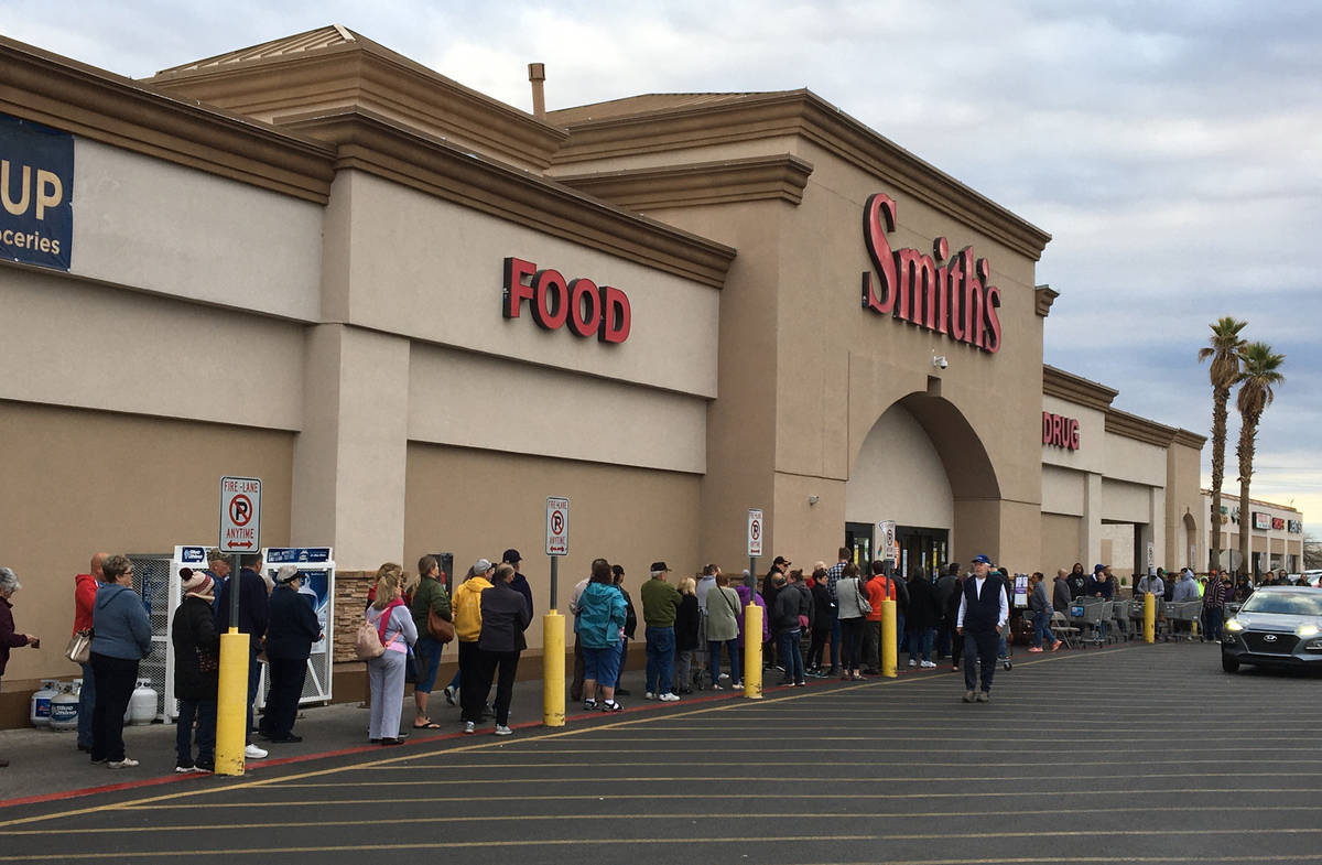 Seniors over 60 line up outside of Smith's in Henderson to get into the grocery store early on ...