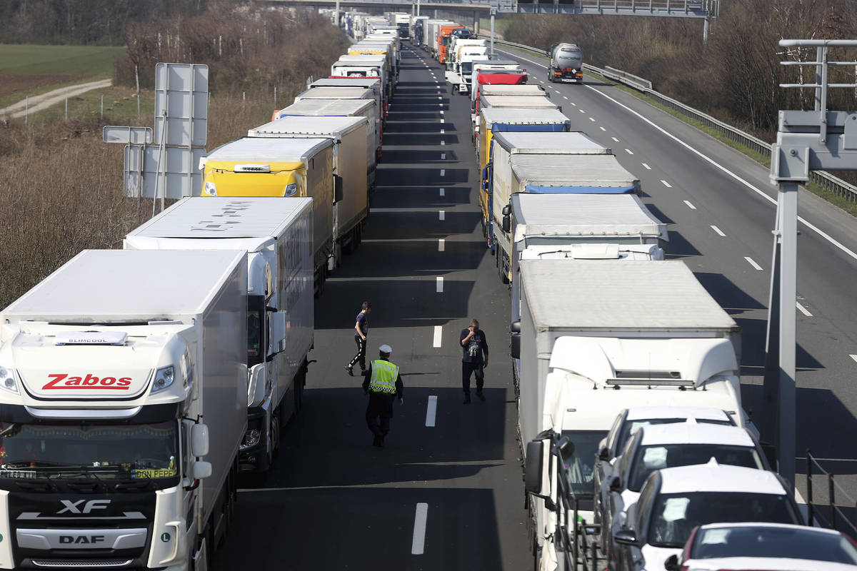 Trucks stand on the highway close to the border between Austria and Hungary near Bruck an der L ...
