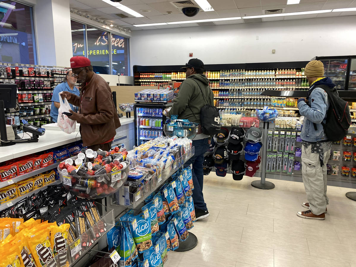 Shoppers at Walgreens at Fremont Street Experience in downtown Las Vegas Wednesday, March 18, 2 ...