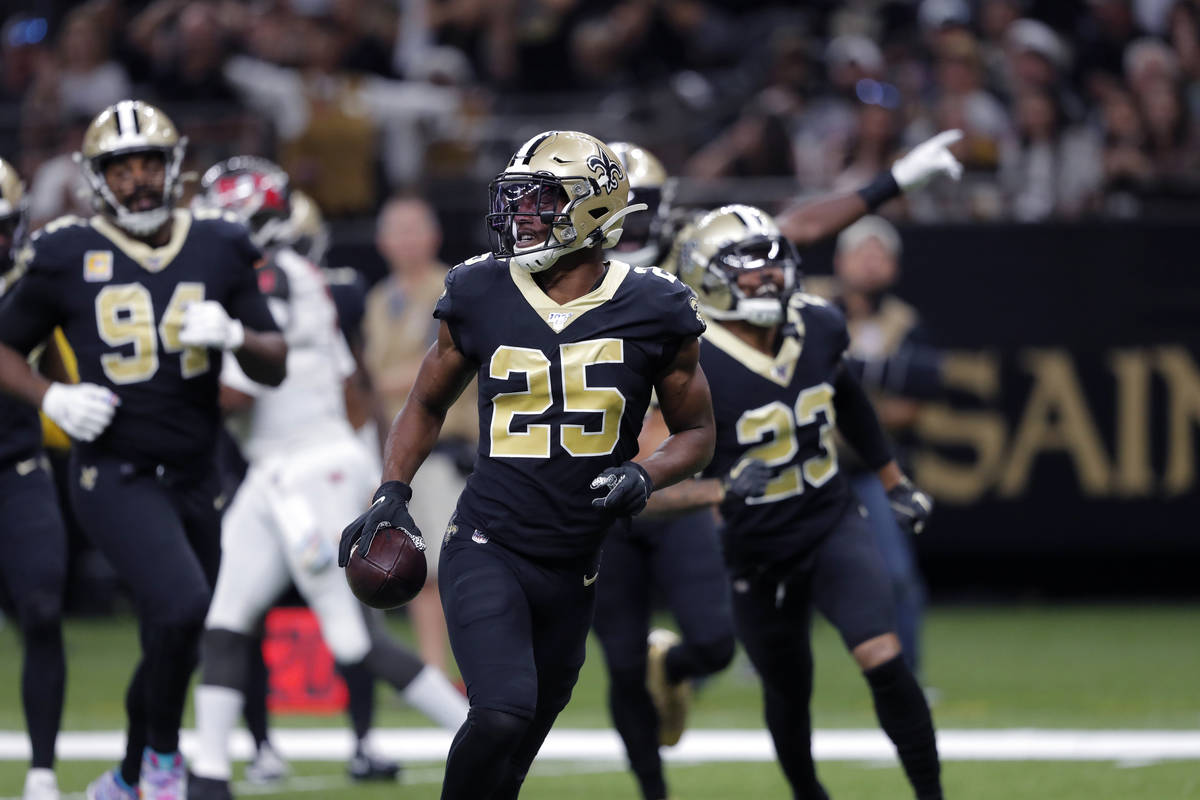 New Orleans Saints cornerback Eli Apple (25) holds the football after an interception that was ...