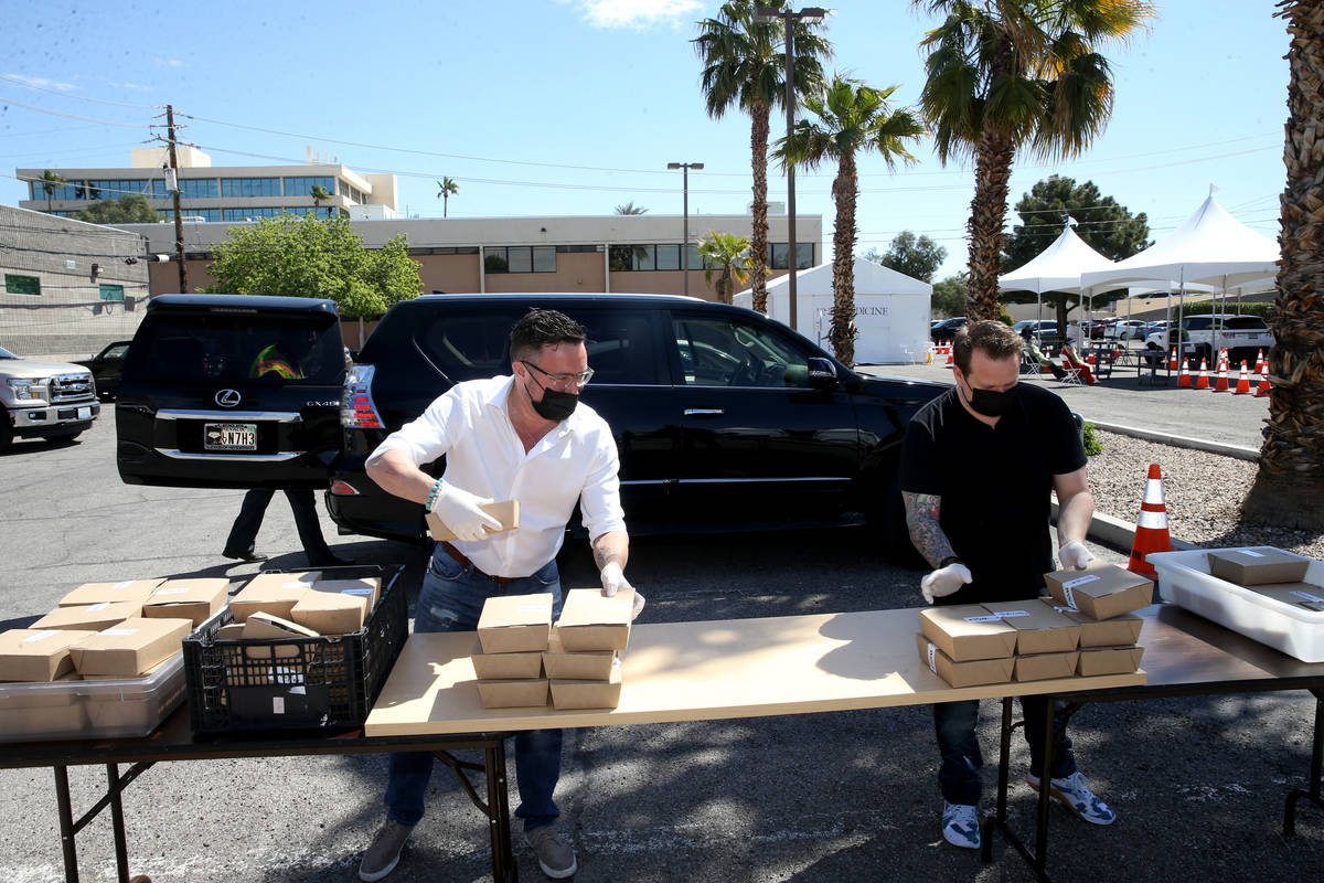 John Anthony, left, and Brian Howard, co-owners of Sparrow + Wolf restaurant, deliver food to p ...