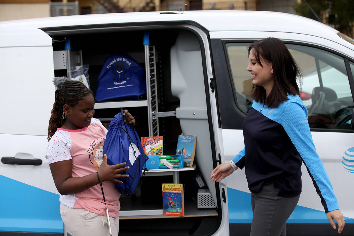 Jeanette Rupert, an in-home expert with AT&T, gives a kit with hygiene products, academic mater ...