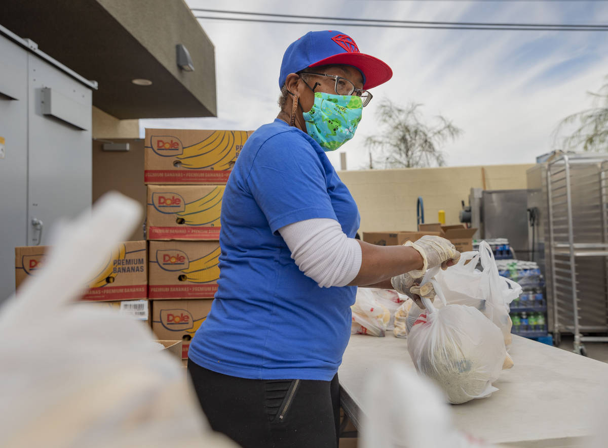 Family care manager for Lutheran Social Services of Nevada Trnee Stephenson bags fruit for emer ...