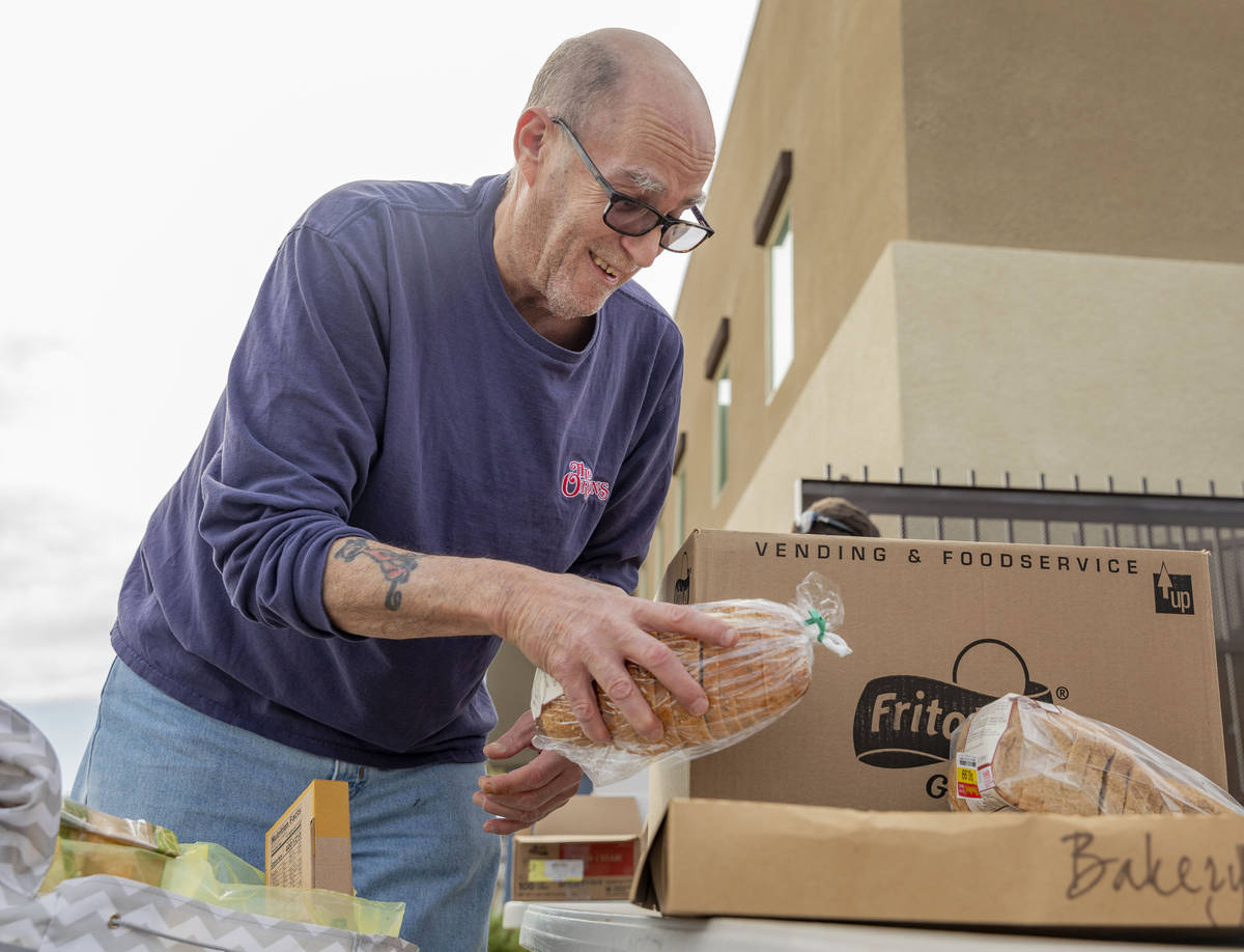Richard Brint, 63, of Las Vegas collects and emergency food box from Lutheran Social Services o ...