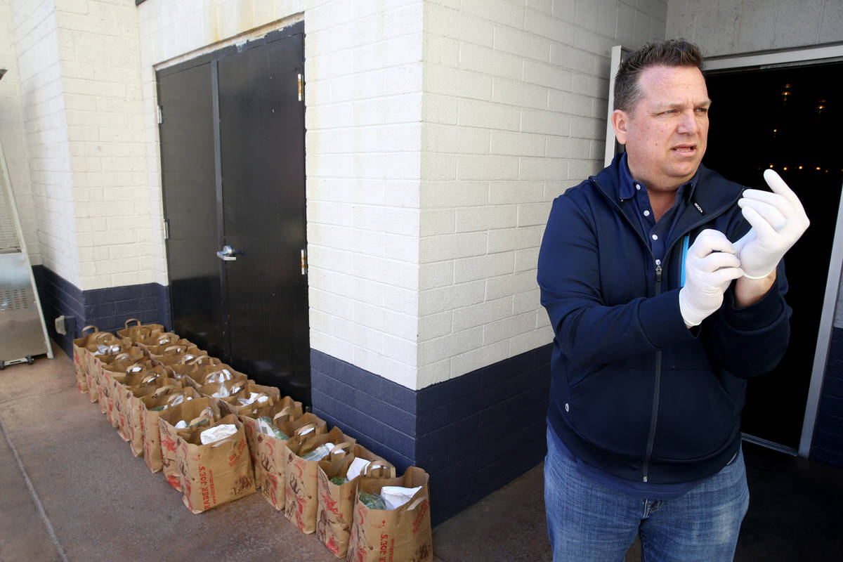 Carson Kitchen owner Cory Harwell prepares to deliver food bags to laid off employees at his La ...