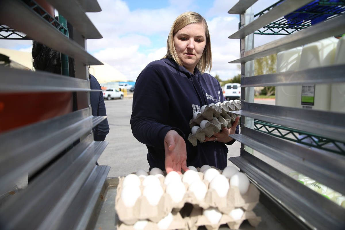 Food and beverage manager Julia Posada picks up eggs for team members at the M Resort hotel-cas ...