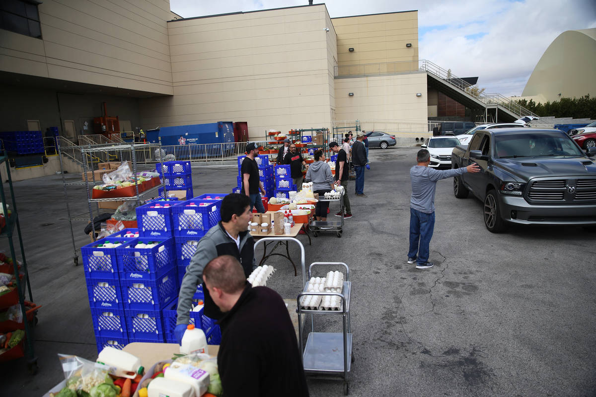 Team members hand out food to co-workers outside of the loading dock at the M Resort hotel-casi ...