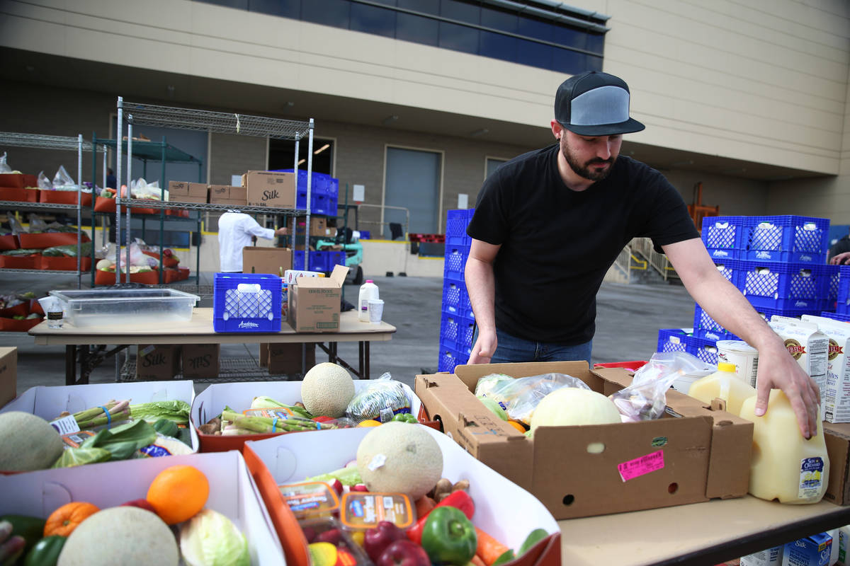 Director of entertainment Justin Teixeira organizes food to be picked up by team members at the ...