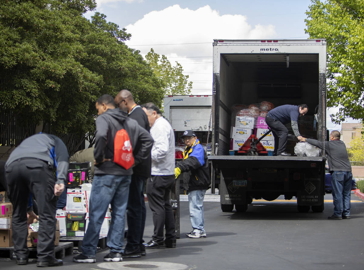Metropolitan police and a group of MGM chefs teamed up to distribute food MGM restaurants can n ...