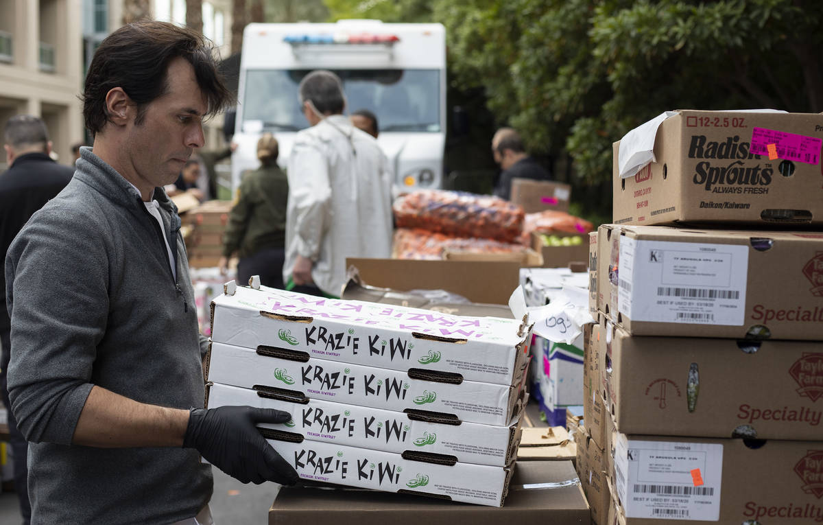 Anthony Amoroso, corporate executive chef for MGM Resorts, unloads kiwi to be donated to the pu ...