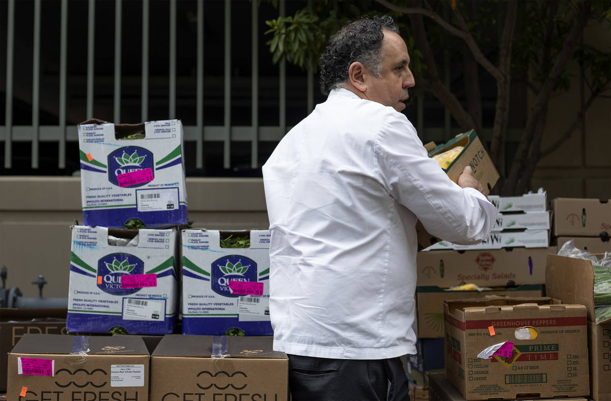 Chef Carlos Guia, executive chef at ARIA, unloads food donated by MGM Resorts outside the Las V ...