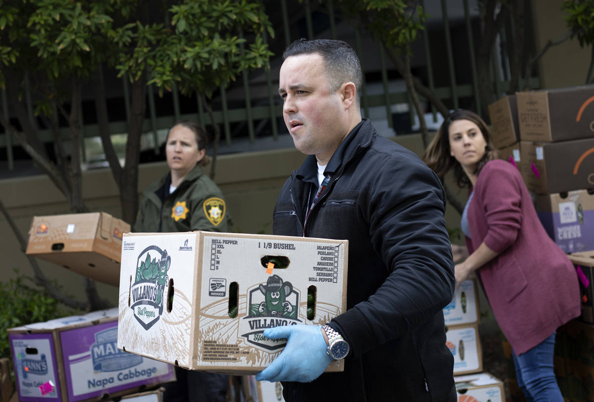 Officer Marc Viskoc helps stage a food donation from MGM Resorts outside the Las Vegas Metropol ...