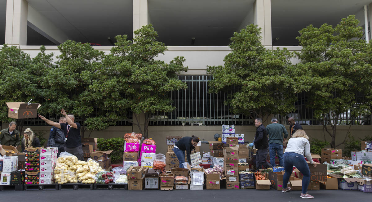 Food donated by MGM is up for grabs outside the Las Vegas Metropolitan Police Department headqu ...