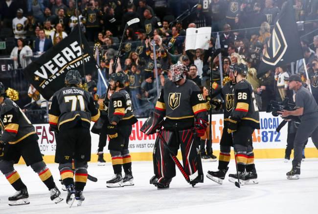 Golden Knights goaltender Robin Lehner (90) celebrates with his teammates after an NHL hockey g ...