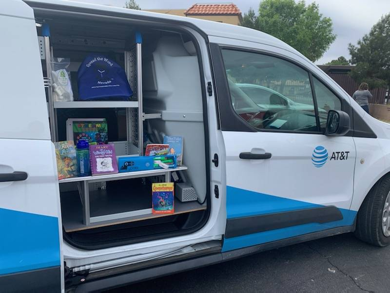 AT&T employees delivered 10,000 kits to Clark County School District students who attend high-p ...