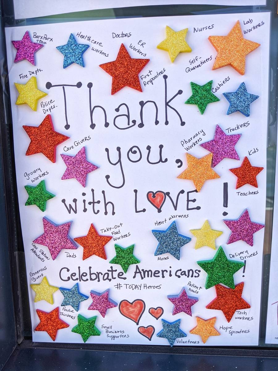 Messages of appreciation and support for first responders and others are displayed at Barx Parx ...