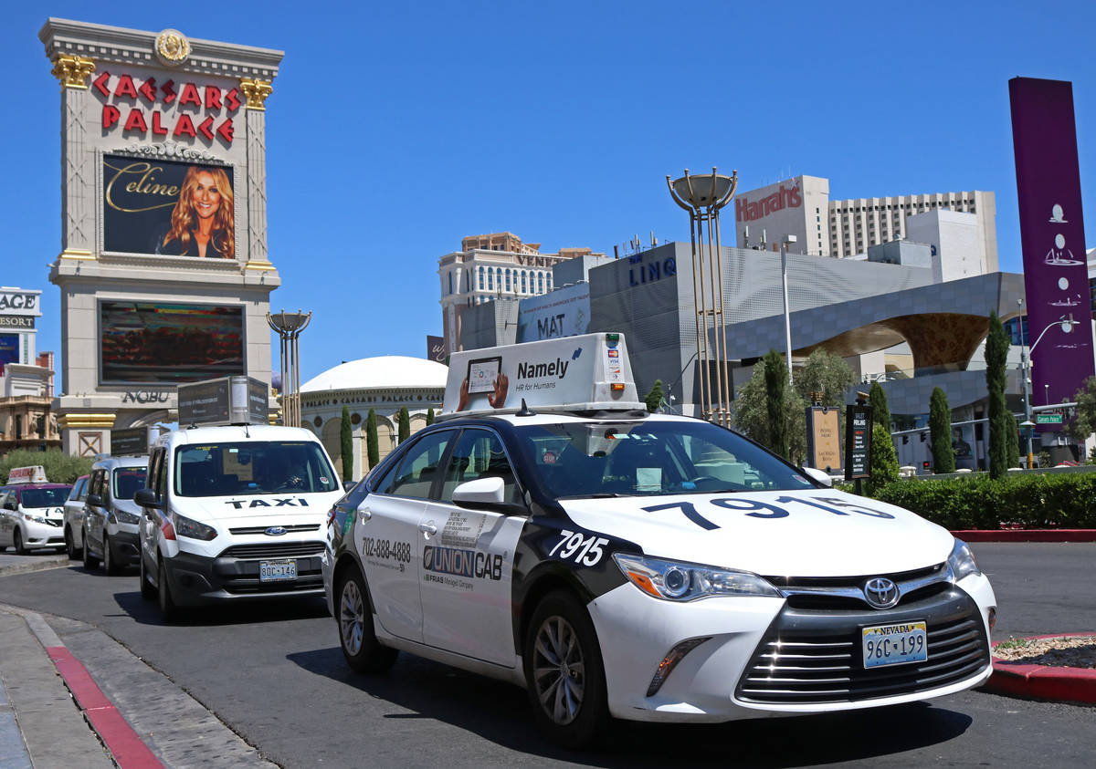 Cab drivers pull into the taxi pick up lane at Caesars Palace in Las Vegas, Thursday, April 20, ...