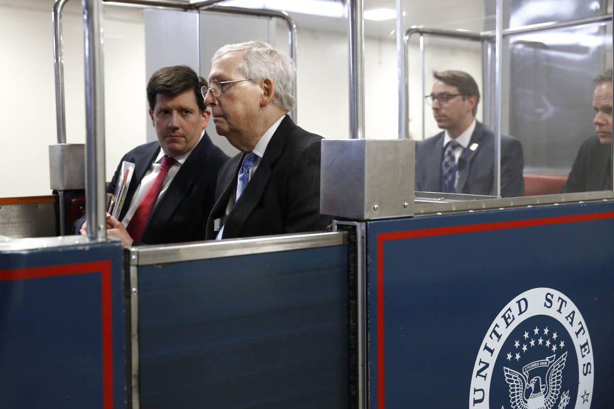 Senate Majority Leader Mitch McConnell of Ky., rides a subway car on Capitol Hill in Washington ...