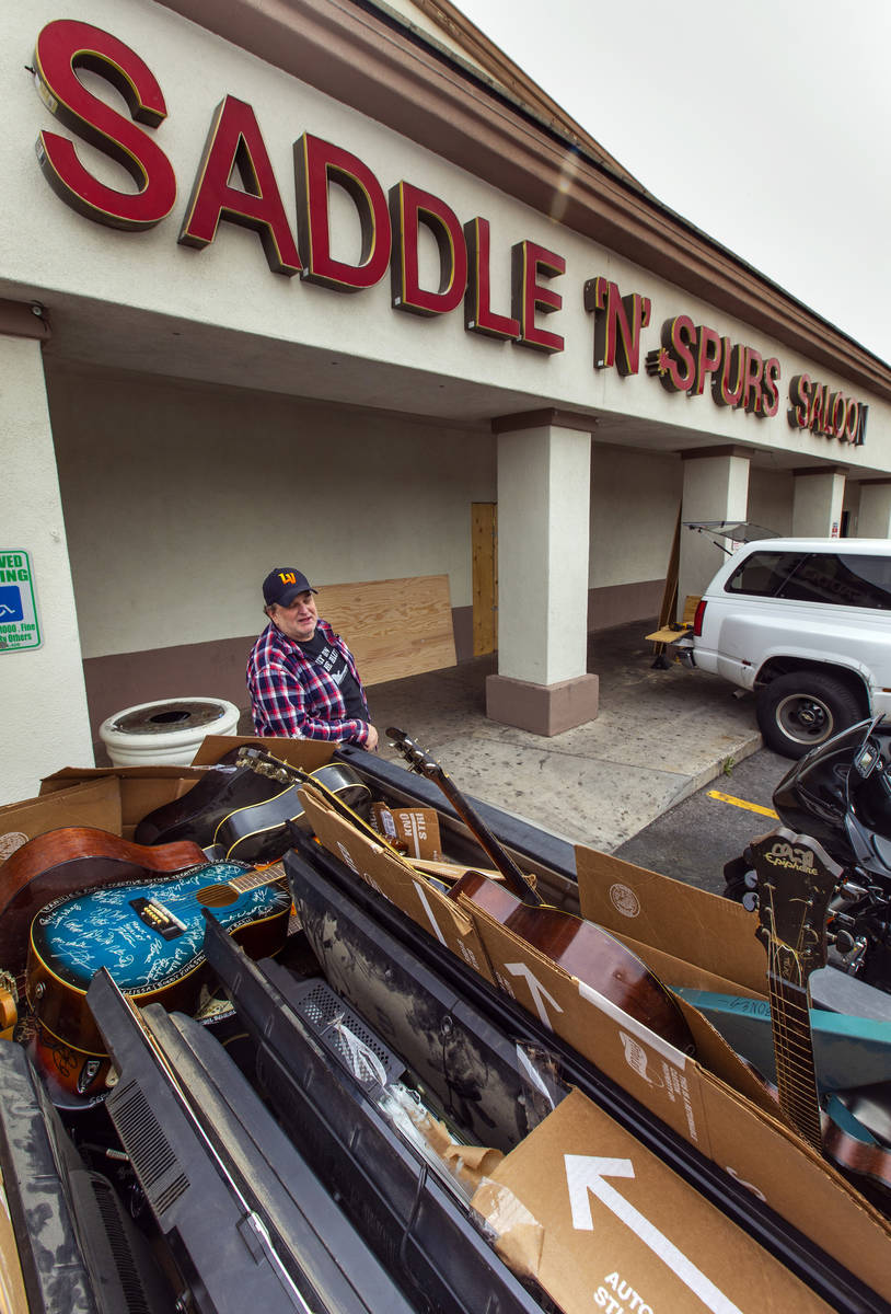Saddle 'N' Spurs Saloon owner Bobby Kingston beside his packed up his pickup truck with signed ...