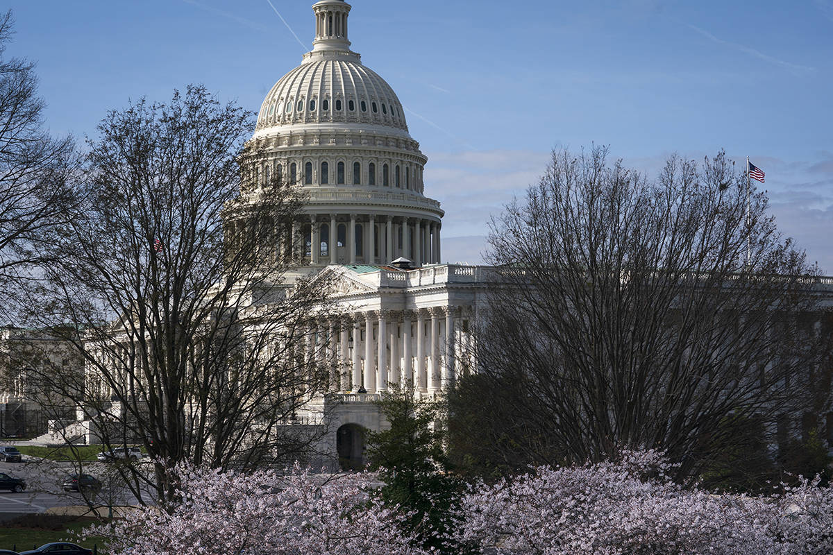 The Capitol is seen as lawmakers negotiate on the emergency coronavirus response legislation, a ...