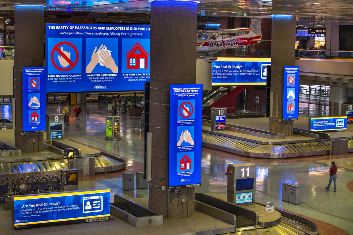 Safety messages are displayed to passengers and employees in the baggage area in Terminal 1 at ...