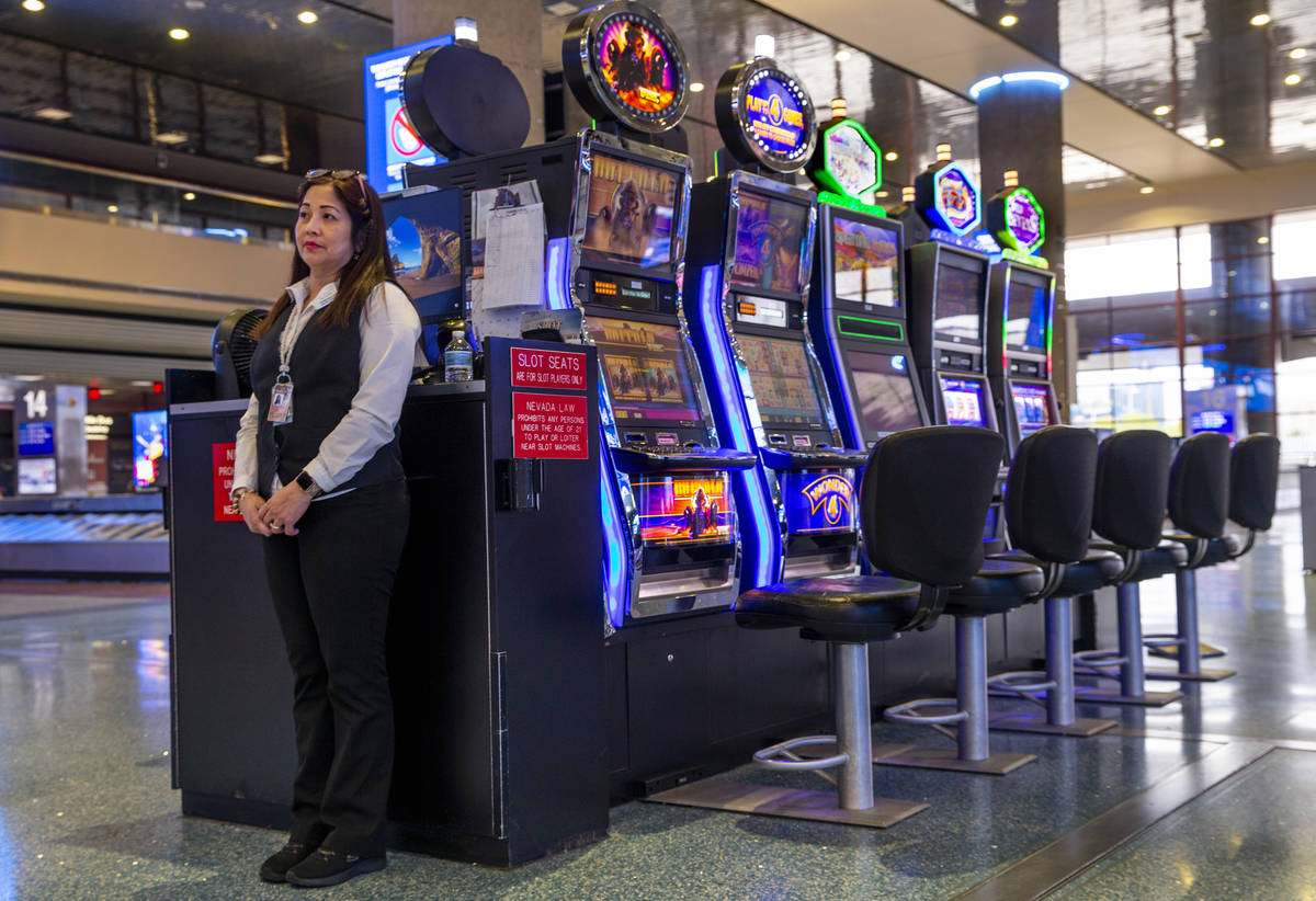 Slots employee Marites Mallari awaits possible players in the baggage area in Terminal 1 at McC ...