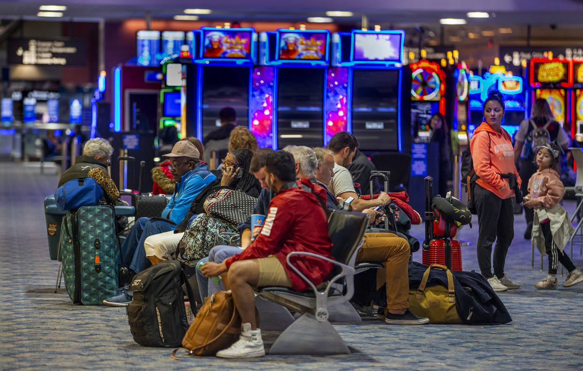 Passengers kill some time awaiting their flights in Terminal 1 at McCarran International Airpor ...