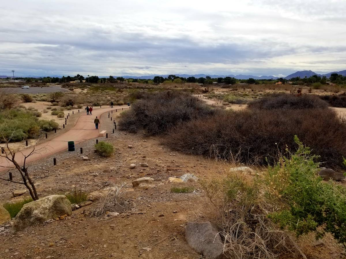 Walkers and runners keeping their social distances while getting fresh air Wednesday at Dunes D ...