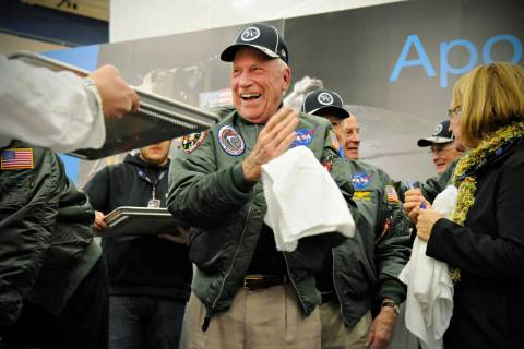 FILE - In this Wednesday, Nov. 12, 2014 file photo, Apollo 15 astronaut Al Worden wipes his han ...