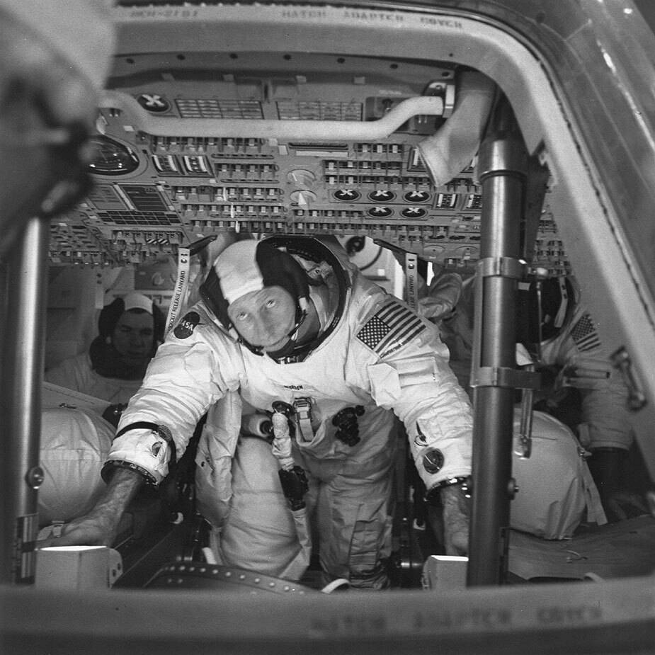 This March 26, 1971 photo made available by NASA shows astronauts Al Worden, center, Dave Scott ...