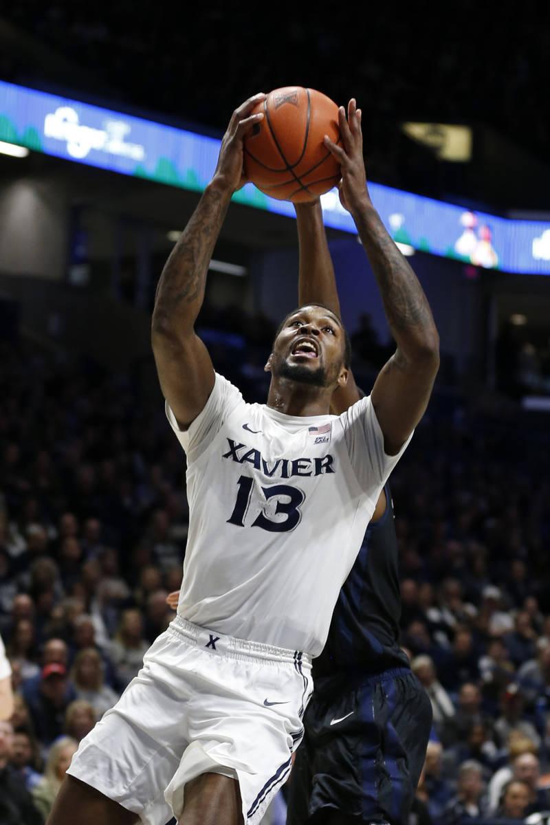 Xavier forward Naji Marshall (13) shoots against Butler during the first half of an NCAA colleg ...