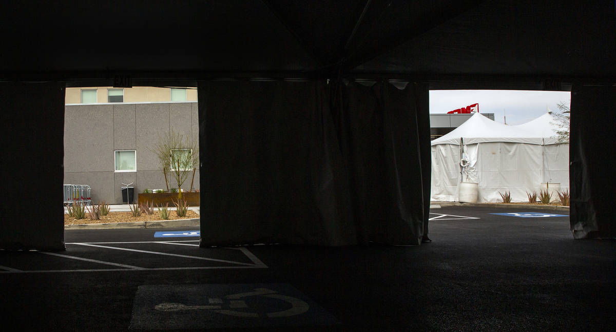 Sunrise Hospital has erected tents, currently empty, in their parking lot near emergency/trauma ...