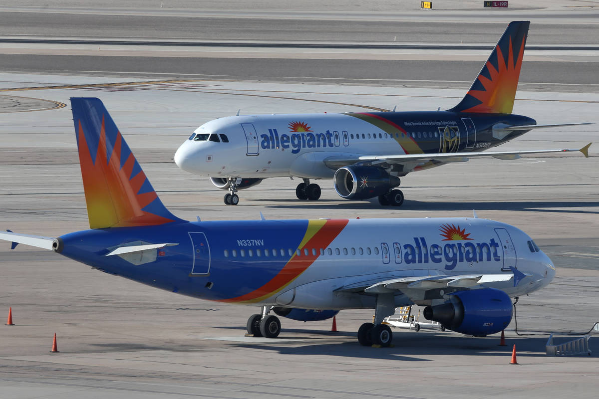 Two Allegiant Air airplanes are seen on the tarmac at McCarran International Airport in Las Veg ...