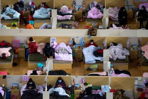 In this Monday, Feb. 17, 2020, photo released by Xinhua News Agency, patients infected with the ...
