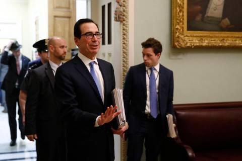 Treasury Secretary Steve Mnuchin asks members of the media to practice social distancing as he ...