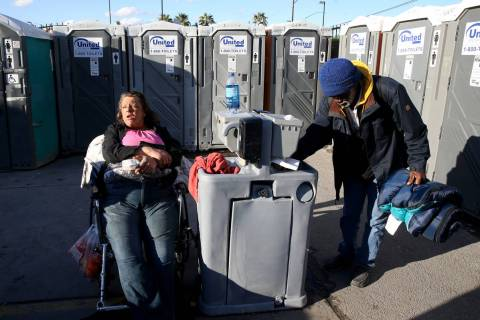 "Erica ""E.Z."" Zehm, 42, at hand washing stations at The Courtyard Homeless Resource Ce ..."