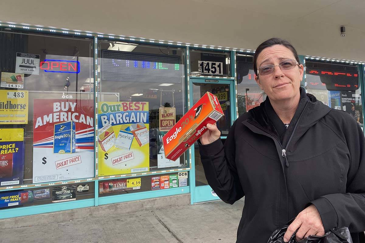 Amy Brown of Las Vegas holds a carton of cigarettes she bought at The Smoke Shop, 1451 Jones Bl ...