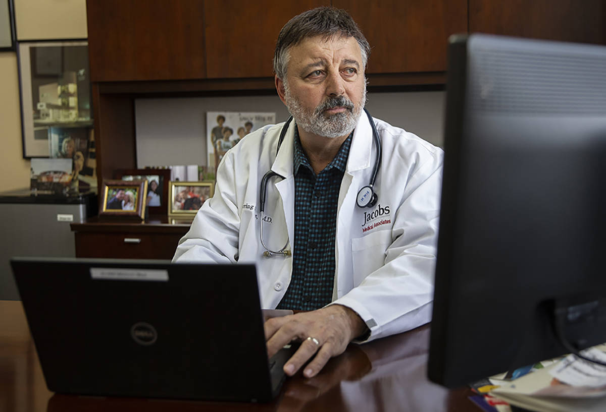 Primary care physician Dr. Loring Jacobs at his office in Henderson on Friday, March 20, 2020. ...