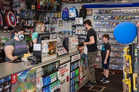 Customers purchase items at the GameStop store at 947 South Rainbow Boulevard in Las Vegas whil ...